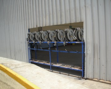 Reels With Hose And Nozzle For Dispensing Lubricants